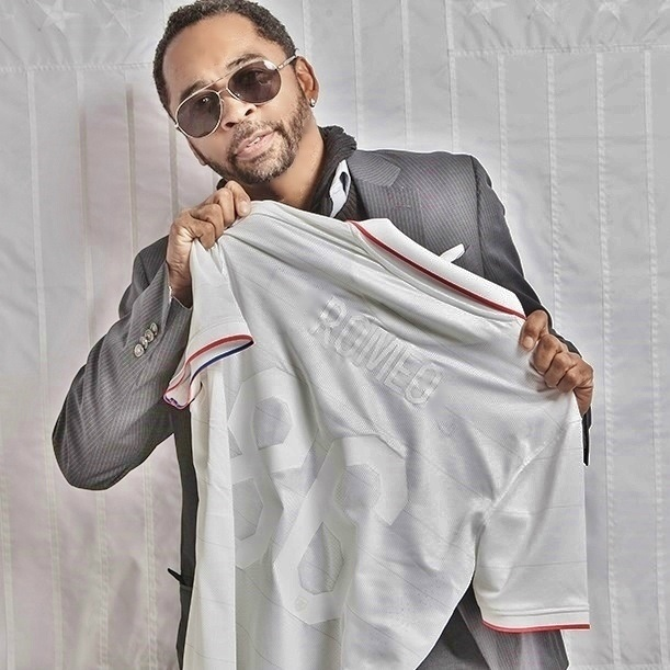 HOMBRE Magazine's Francisco Romeo holds his new peronalized US Soccer team jersey
